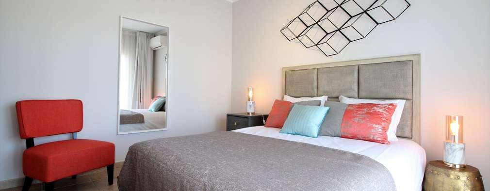 Dormitorios de estilo ecléctico por Ana Leonor Rocha