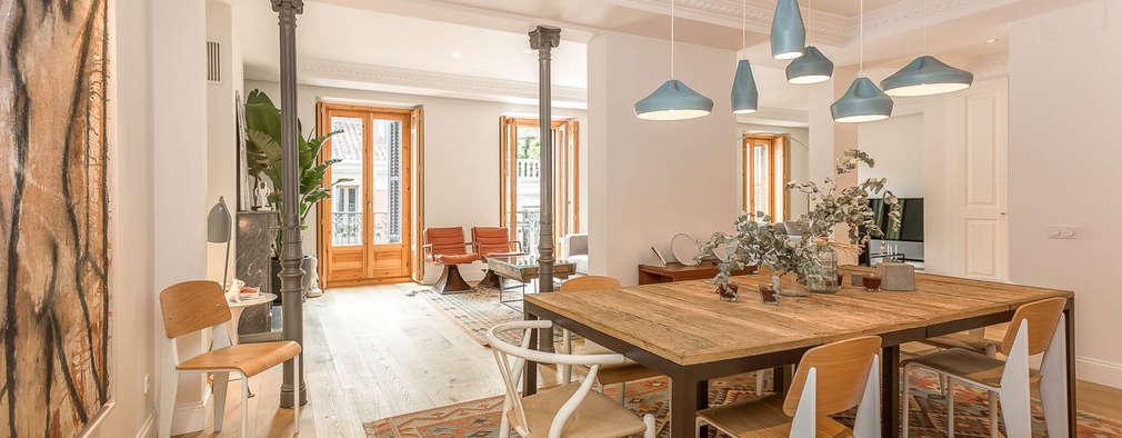 Sala da pranzo in stile in stile Moderno di CABALLERO Fotografía de Arquitectura, Inmobiliaria e Interiorismo