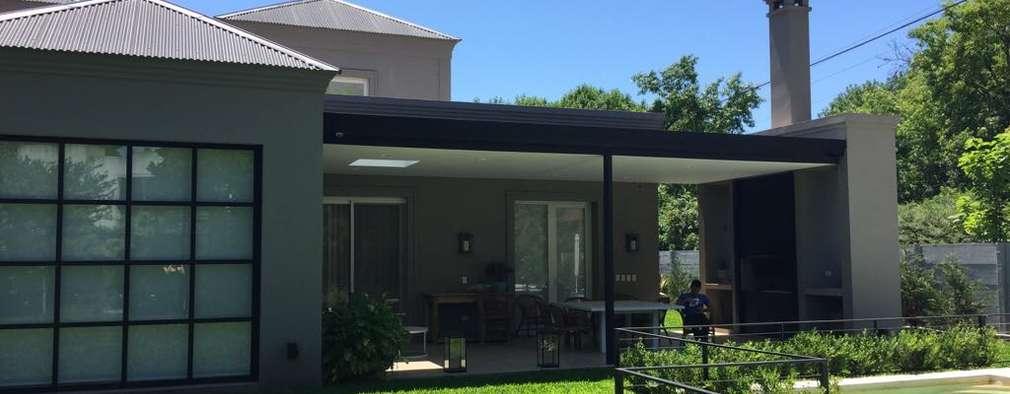 Casas unifamiliares de estilo  por Estudio Dillon Terzaghi Arquitectura