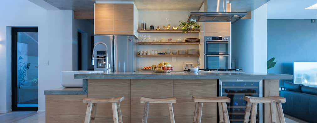 Oak kitchen with concrete tops:  Kitchen units by JBA Architects