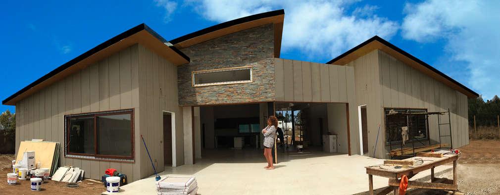 Fachada Nordeste: Casas de estilo moderno por ARquitectura