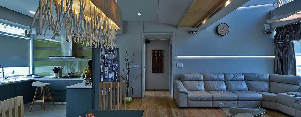 living area: minimalistic Living room by Design Paradigm
