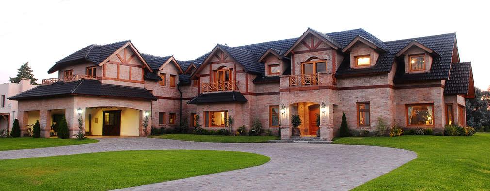 Country Normando: Casas de estilo clásico por CIBA ARQUITECTURA
