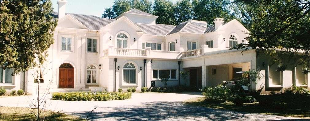 Casa clásica estilo francés en Club Argentino de Golf : Casas unifamiliares de estilo  por Estudio Dillon Terzaghi Arquitectura