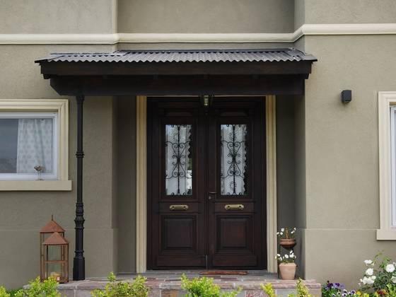 Fachadas modernas puertas portones minimalistas automticos for Puertas de casa exterior