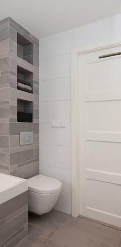 Baños de estilo moderno por Het Ontwerphuis