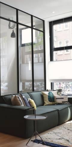 Salas de estar  por Atelier09