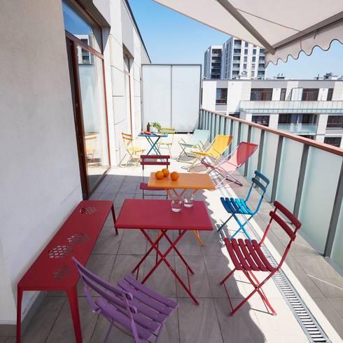Balcones, porches y terrazas de estilo  por Pracownia Projektowa Hanna Kłyk