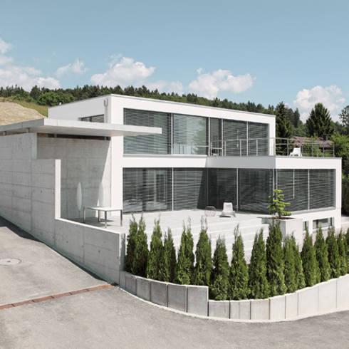 Einfamilienhaus im Schweizer Mittelland: minimalistische Häuser von Unica Architektur AG