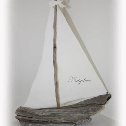 bateau en bois flotté: Maison de style  par Natydeco