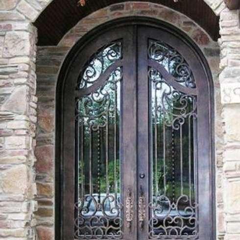 15 puertas de herrer a que te encantar n for Agarraderas para puertas de vidrio