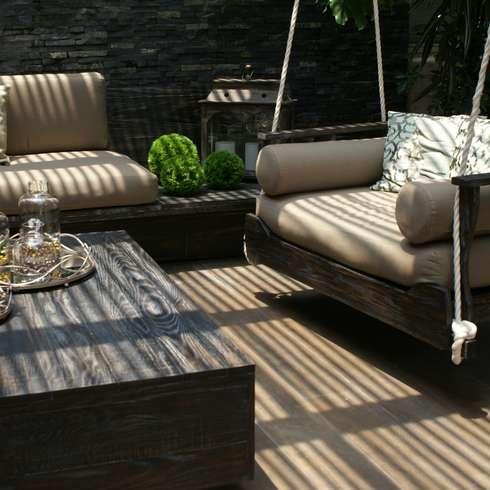 balcones porches y terrazas de estilo moderno por jacobs interiorismo - Sillones Colgantes