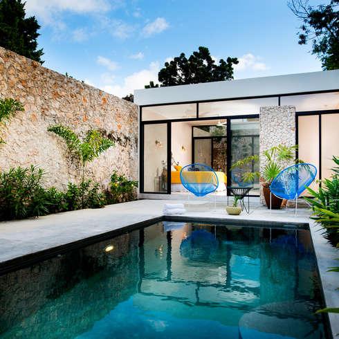 Las mejores ideas para aprovechar la piscina for Piscina en jardin de 100 metros