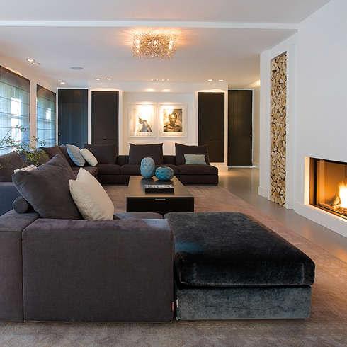 Villa in 't Gooi: moderne Woonkamer door Designa Interieur & Architectuur BNA