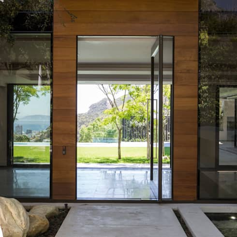 The Front Door to the House: modern Houses by Jenny Mills Architects