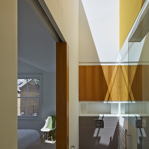 Ensuite bathroom lit by skylight Neil Dusheiko Architects Modern bathroom