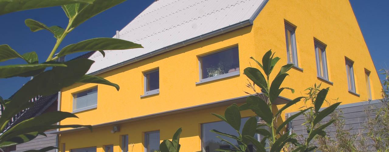 Casas de estilo ecléctico de Architekturbüro Riek Ecléctico