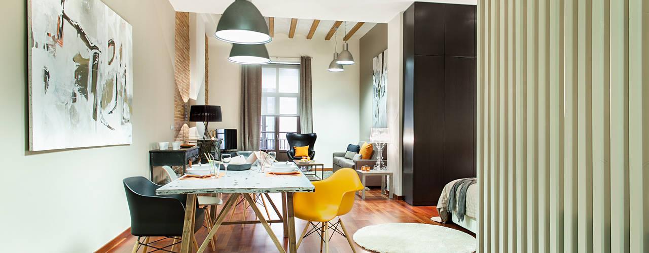 Salas de estilo industrial por Home Deco Decoración