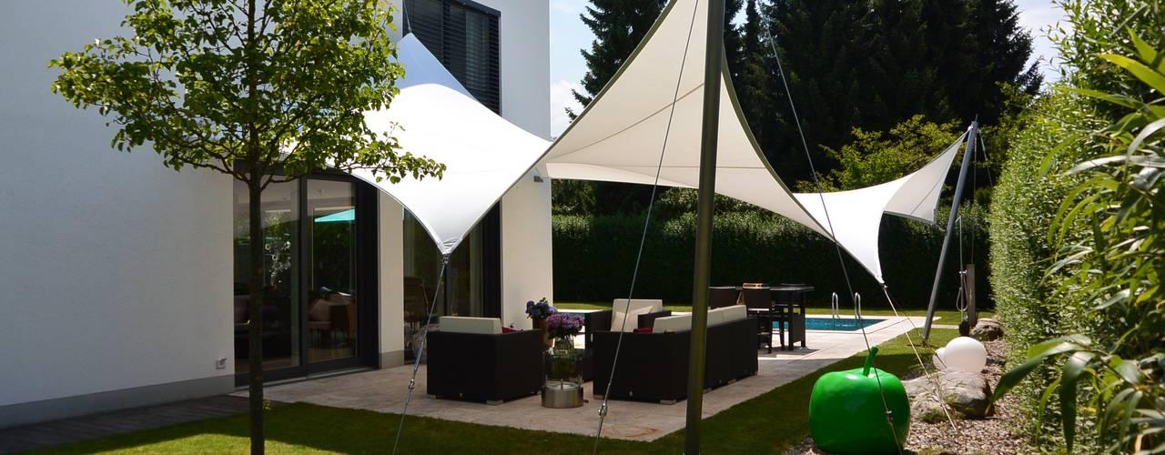 Terrazas de estilo  por aeronautec GmbH, Moderno