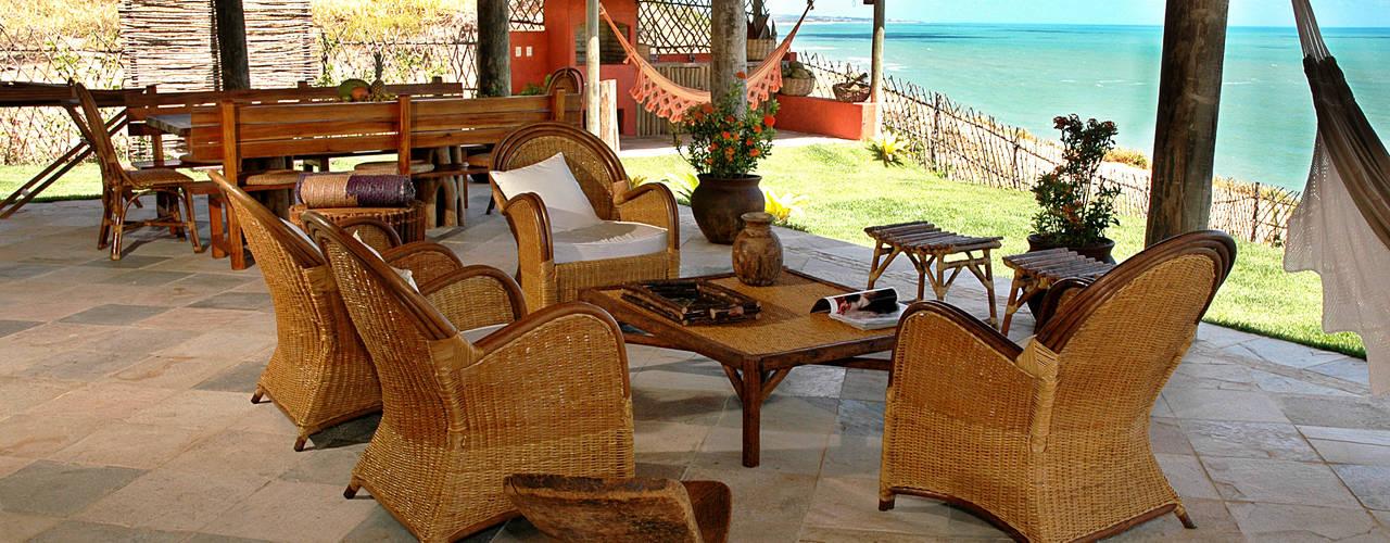 Projeto Varandas, alpendres e terraços campestres por Isnara Gurgel - Arquitetura + Interiores Campestre
