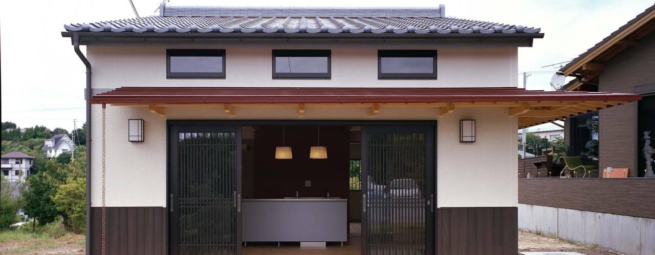 Casas eclécticas de 株式会社 遊墨設計 Ecléctico