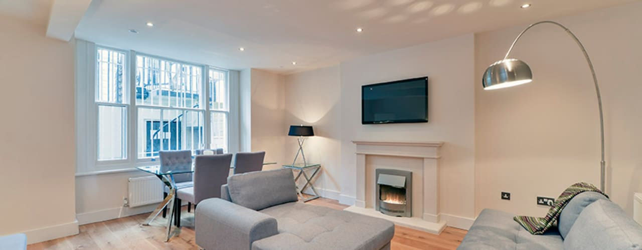 Bayswater - Basement Flat Conversion:  Living room by The Lady Builder,