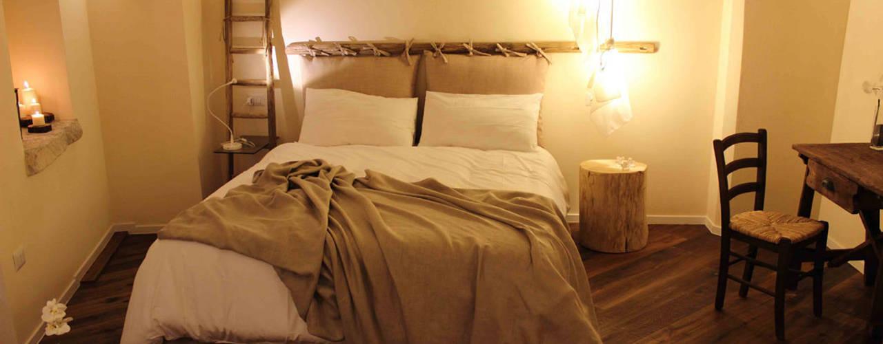Dormitorios de estilo rústico de FRANCESCO CARDANO Interior designer Rústico