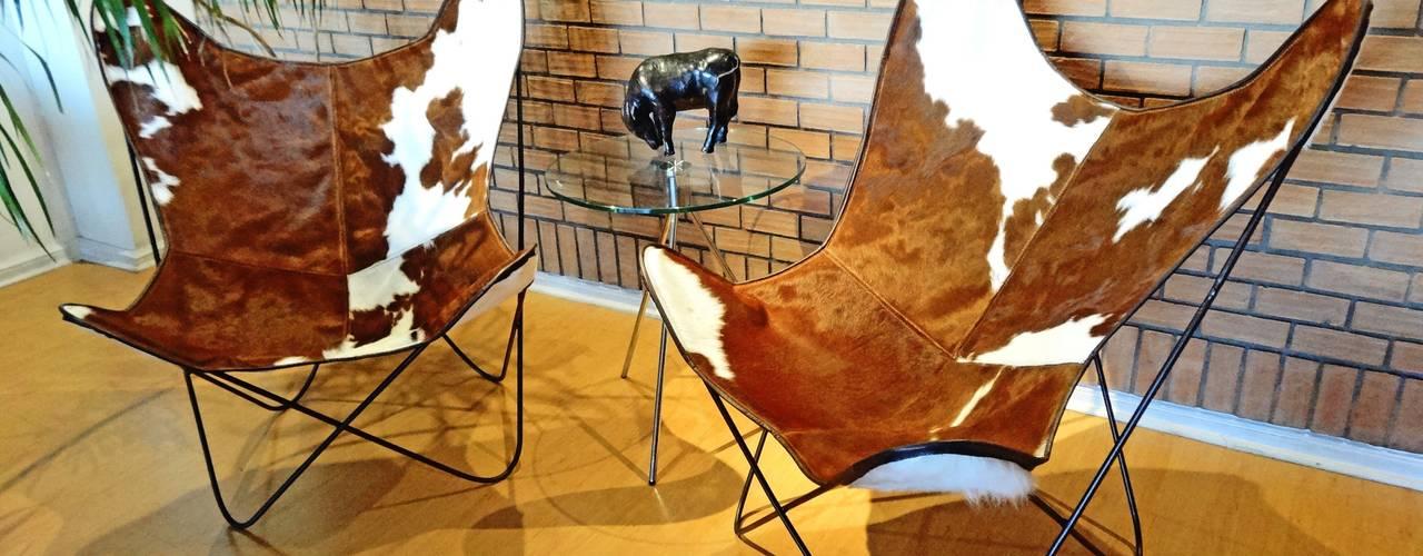 SILLON BKF EN CUERO VACUNO:  de estilo  por TAYLOR DECORACIONES,Moderno
