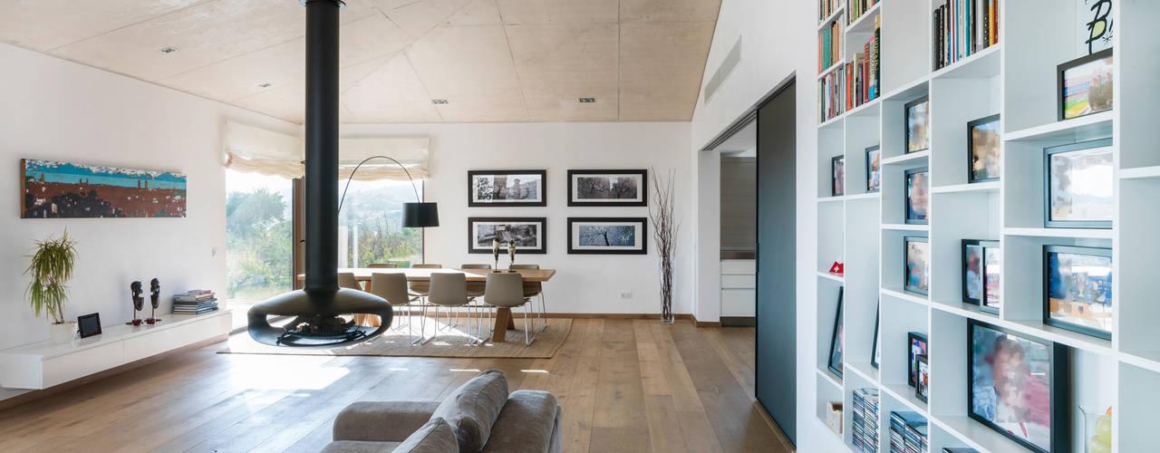 Salas / recibidores de estilo  por margarotger interiorisme