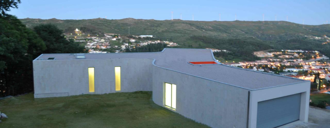 by 100 Planos Arquitectura Lda