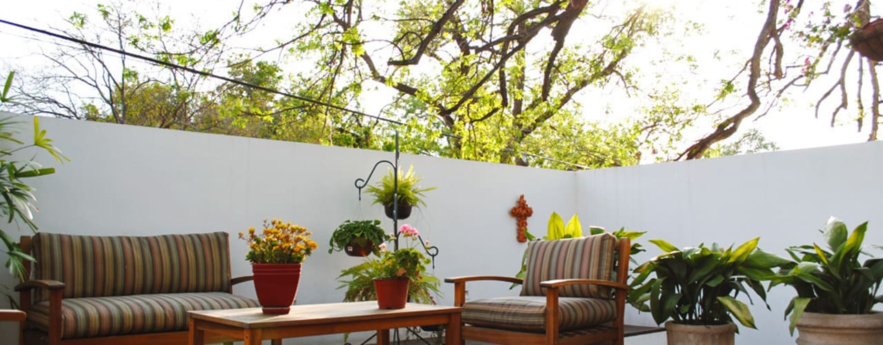 Balcones y terrazas de estilo rústico de CORTéS Arquitectos Rústico