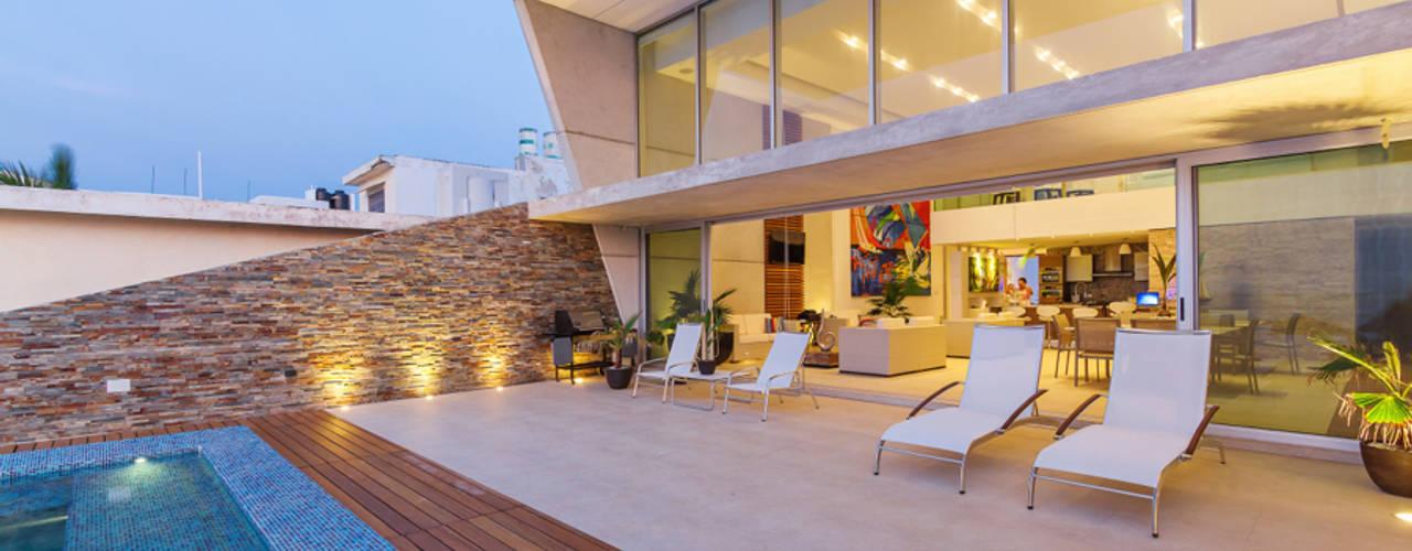 Дома в стиле минимализм от Enrique Cabrera Arquitecto Минимализм