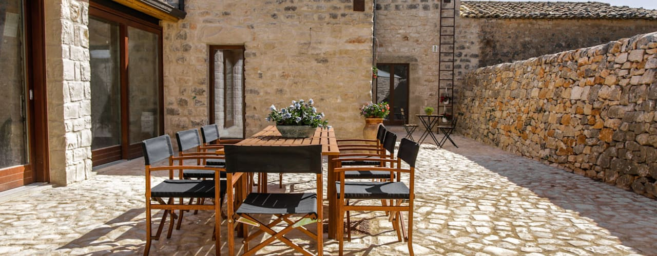 Country style garden by Viviana Pitrolo architetto Country
