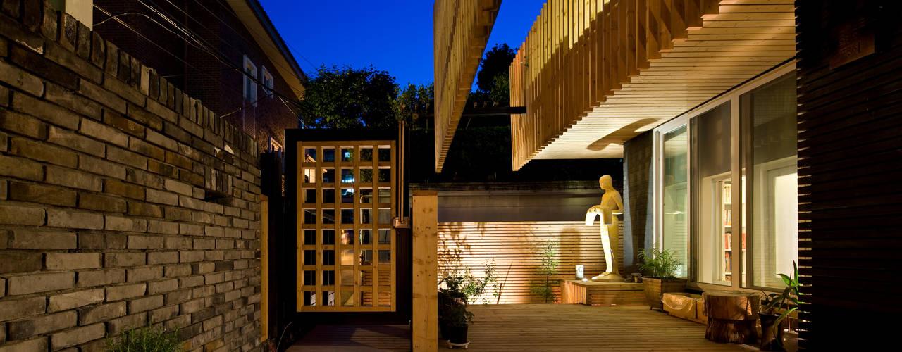 Casas modernas por 무회건축연구소 Moderno
