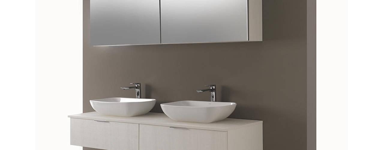 Baños de estilo  por Ceramica Althea
