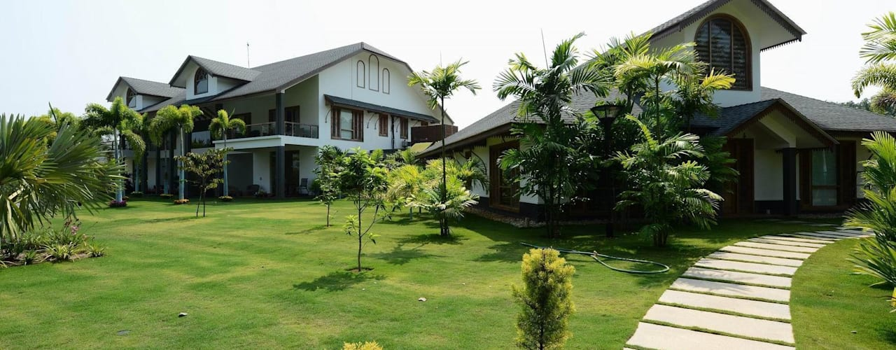 PRIVATE RESIDENCE AT KERALA(CALICUT)INDIA TOPOS+PARTNERS Classic style garden