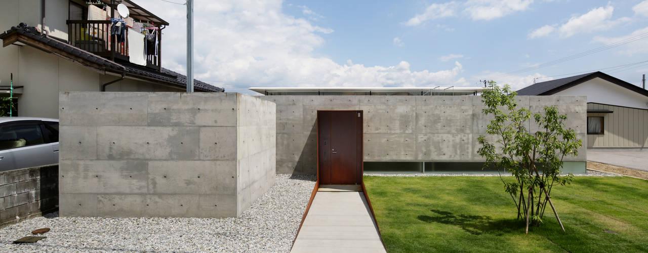 Casas minimalistas por TNdesign一級建築士事務所