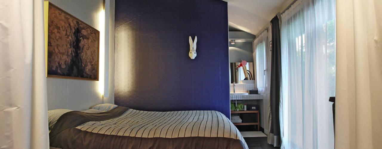 Phòng ngủ phong cách chiết trung bởi BuroBonus Chiết trung