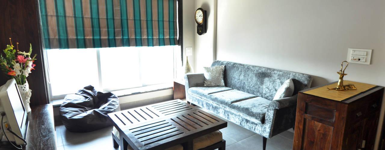 RESIDENCE AT VILE PARLE (E):  Living room by Dhruva Samal & Associates