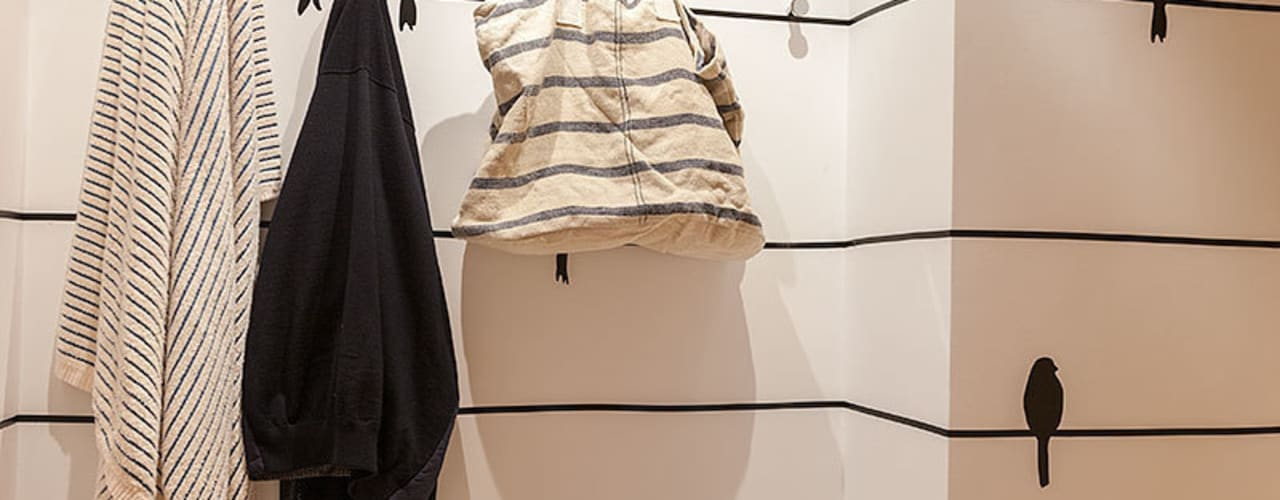 Vestidores y closets de estilo  por Urbana Interiorismo