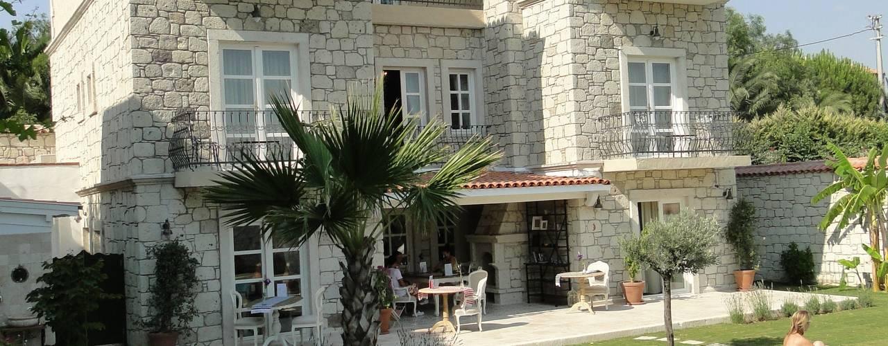 Hoteles de estilo mediterráneo de Tuncer Sezgin İç Mimarlık Mediterráneo