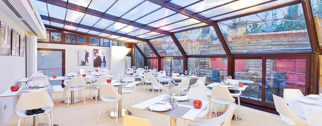 """Cenare sotto le stelle in un set cinematografico nel centro di MIlano - il nuovo ristorante """"Parentesi"""" arcHITects srl Negozi & Locali commerciali in stile industrial"""