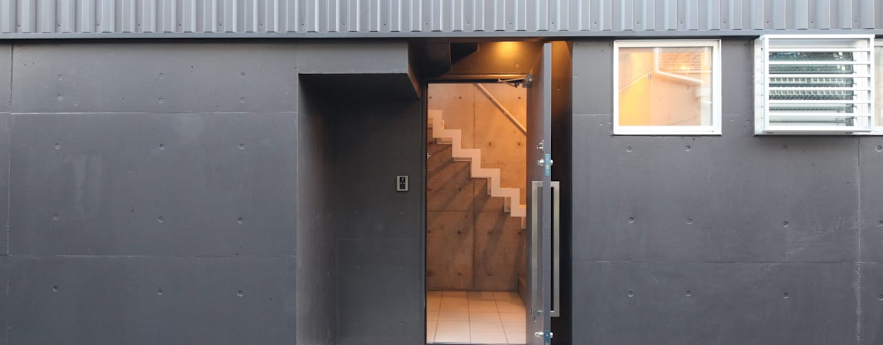 Casas modernas por atelier m