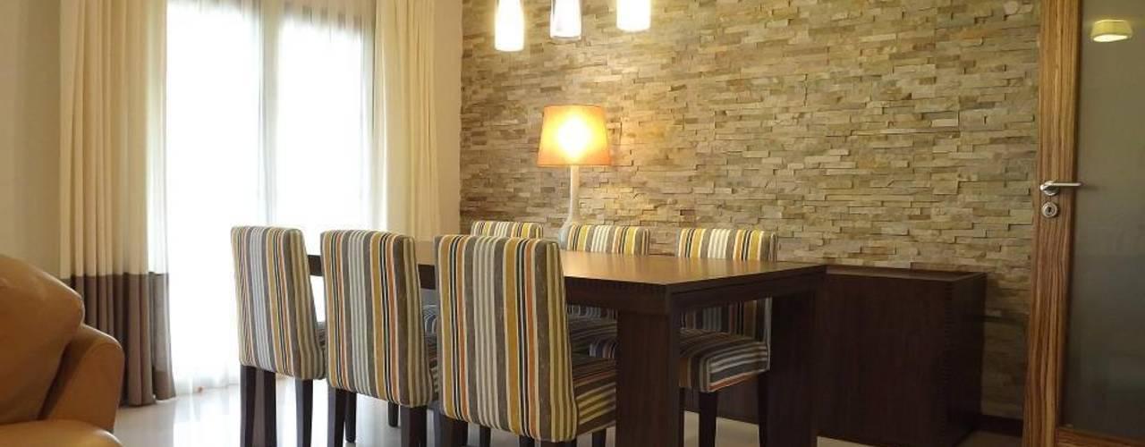 Zona de refeições: Salas de jantar  por Traço Magenta - Design de Interiores