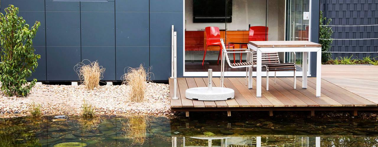 Сады в . Автор – GarDomo Designgartenhäuser