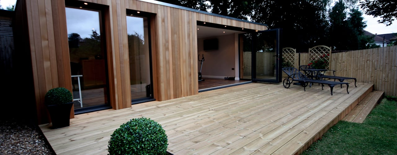 Garden treatment room and gymnasium:  Garden by The Swift Organisation Ltd