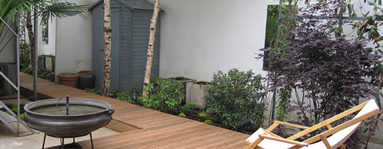 Jardines de estilo  por  GARDEN TROTTER
