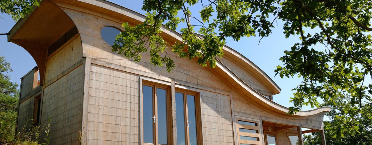 Maison écologique de José Bové: Maisons de style  par eco-designer