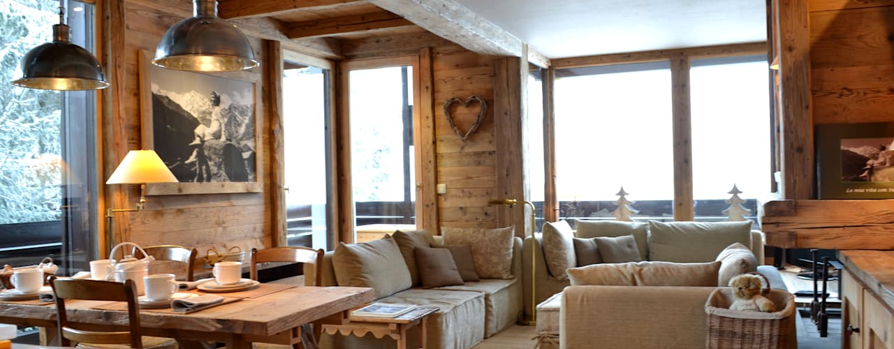 Salon rustique par Andrea Rossini Architetto Rustique