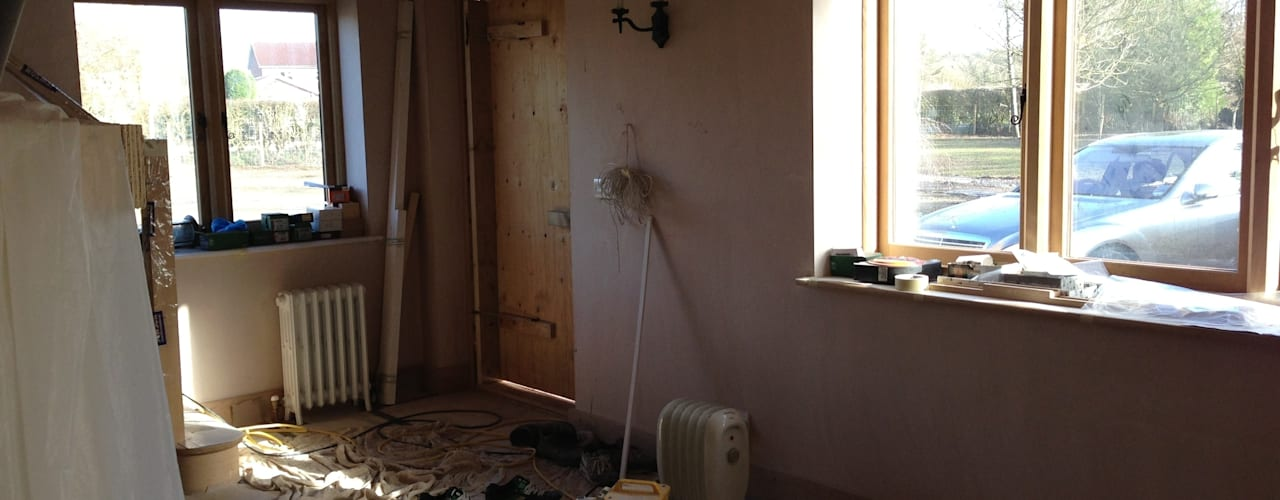Barn Conversion - Hallway newly plastered and windows fitted:   by Design by Deborah Ltd